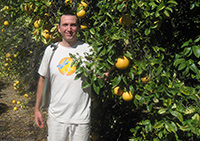 Photo of Dr. Todd visiting an orange grove