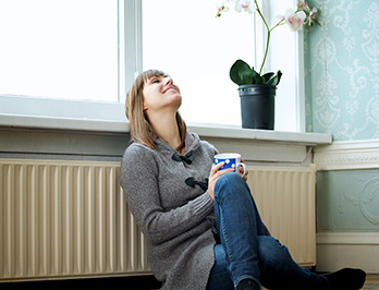 photo of a woman enjoying her tea